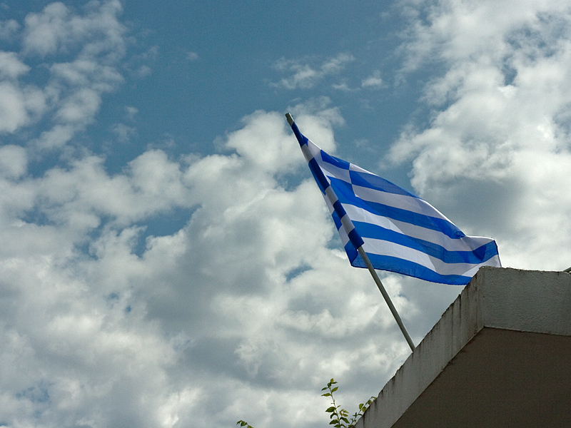 Greek flag in Corfu taken my Michael Common